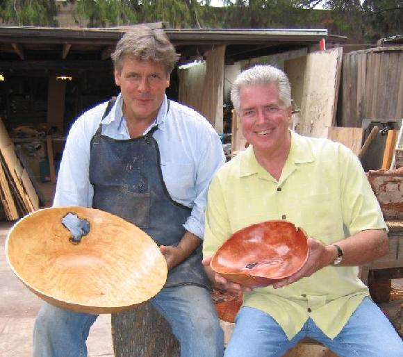 John Talbot and Huell Howser pose with wood bowls during a KCET interview.
